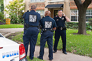 Police stand outside the apartment of Nina Pham who was the first confirmed case of Ebola contracted in the United States, in Dallas, Texas on October 12, 2014. Pham, a nurse at Texas Health Presbyterian Hospital, came in contact with Thomas E. Duncan who traveled from Liberia to Dallas to visit his girlfriend and family unknowingly carrying the Ebola virus.