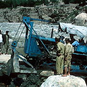 21 May 1976<br /> Close-up on Bulldozer from the side, Workmen.