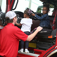 Lauren Wood | Buy at photos.djournal.com<br /> Firefighter Jake Bennett shows Jalynn Cummings and Makinley Lowe, right, the steering wheel of the firetruck as he and other firefighters from Tupelo Station No. 5 visit the Brown Bear Child Care and Learning Center Wednesday morning.