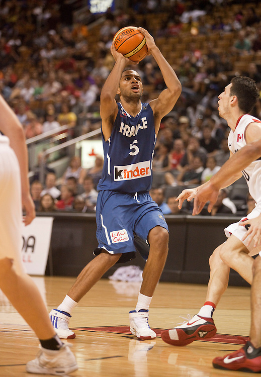 GJR511.jpg -20100813- Toronto, Ontario,Canada<br /> France's Nicolas Batum shoots the ball as France takes on Canada at the 2010 Jack Donohue International Classic basketball tournament in Toronto, Canada August 13, 2010<br /> AFP PHOTO/Geoff Robins