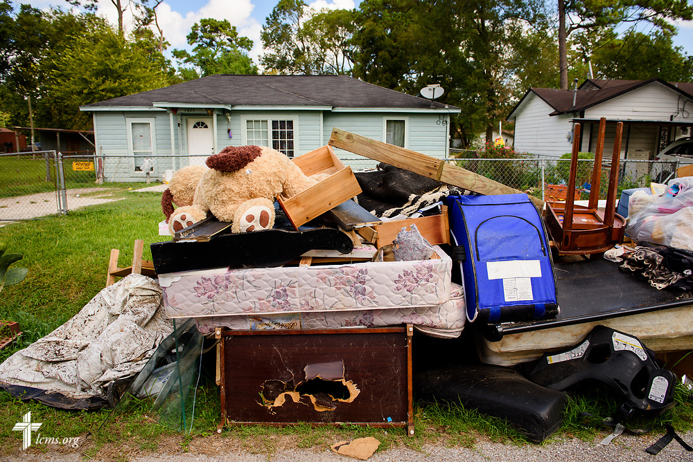 Debris still litters a residential street in Houston on Tuesday, Sept. 26, 2017, weeks after Hurricane Harvey made landfall with devastating winds and catastrophic flooding.  LCMS Communications/Erik M. Lunsford