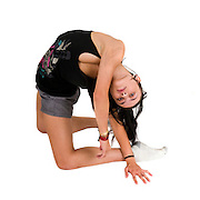 young flexible punk woman on white background