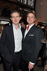 Left to right, TIM GOSLING and JONATHAN COLEMAN at the launch party for Spectator Life hosted by Andrew Neil at Asprey, 167 New Bond Street, London on 28th March 2012.