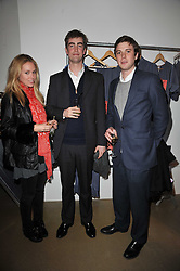 Left to right, EVEIE LONGDON, TOM FABER and ARCHIE SOAMES at a party to launch pop-up store Oxygen Boutique, 33 Duke of York Square, London SW3 on 8th February 2011.