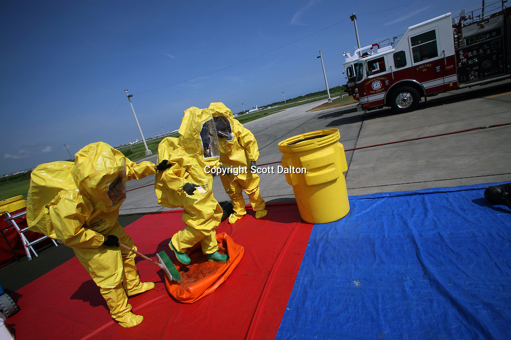 Ecuadorian firefighters show off their training at the US base in Manta, Ecuador on April 14, 2008. The firefighters have been trained by U.S. crews in Manta, the only U.S. base in Ecuador. The Manta air base is used to conduct drug-trafficking surveillance flights. The Ecuadorian government is looking into the possibility of closing the US base once the lease runs out in 2009. (Photo/Scott Dalton).