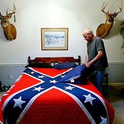 "Democratic strategist, David ""Mudcat"" Saunders, is pictured in his bedroom with Confederate flag bedspread in Roanoke, County, Virginia."
