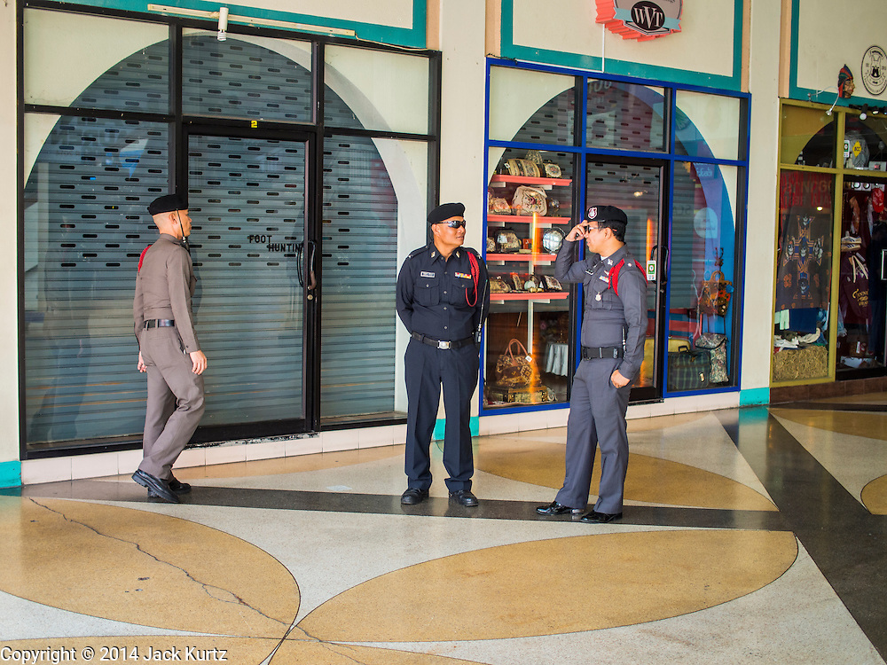 20 NOVEMBER 2014 - BANGKOK, THAILAND: Thai police in the lobby of a movie theater  that cancelled plans to show the new Hunger Games movie. At least three people were arrested by Thai police during the opening the Hunger Games: Mockingjay - Part 1 in Bangkok Thursday. Opponents of the Thai military coup have adapted the three fingered salute used in the Hunger Games series as a sign of their opposition to the coup. In the weeks before the movie opening Thai police arrested several people for using the Hunger Games salute and Thai media reported that one Thai movie theater chain cancelled plans to show the movie at the request of the military government. There were several small protests at theaters showing the movie Thursday.     PHOTO BY JACK KURTZ