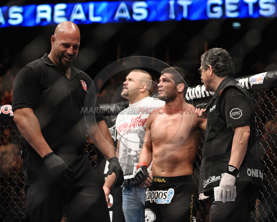 "LONDON, ENGLAND, JUNE 7, 2008: Referee Dan Miragliotta (left) smiles whilst Matt Wiman (Center) watches the large screen replay of his fight, flanked by cornerman Chuck Liddell and cutman Jacob Duran during ""UFC 85: Bedlam"" inside the O2 Arena in Greenwich, London on June 7, 2008."