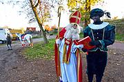 Nederland, Milsbeek, 17-11-2018Sinterklaas en zwarte Piet bereiden zich voor op hun intocht. Sint neemt het grote boek over van Piet.Foto: Flip Franssen