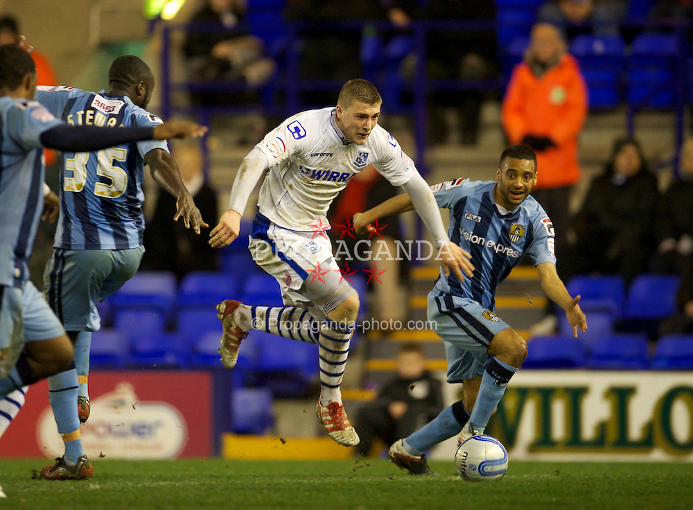 BIRKENHEAD, ENGLAND - Tuesday, March 6, 2012: Tranmere Rovers' Ryan Brunt in action against Notts County during the Football League One match at Prenton Park. (Pic by David Rawcliffe/Propaganda)