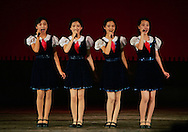 Young North Korean girls sing a tune at the School Children's palace theater in Pyongyang, North Korea Tuesday Aug. 7, 2007.The leaders of North and South Korea will meet this month for the second time since the peninsula's division after World War II, capitalizing on progress in Pyongyang's nuclear disarmament to revive their historic reconciliation.(AP Photo/Elizabeth Dalziel)