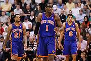 Knicks power forward Amar'e Stoudemire (1) looks toward the bench as forward Wilson Chandler (21) and guard Landry Fields (6) follow behind during an NBA basketball game in Salt Lake City, Wednesday Jan. 12, 2011. (AP Photo/Colin E Braley)