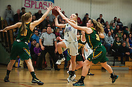 Colchester's Bailey Luter (3) leaps between BFA's Kelly Laggis (30) and Lilly McAllister (20) for a lay up during the girls basketball playoff game between the BFA St. Albans Bobwhites and the Colchester Lakers at Colchester high school on Tuesday night February 23, 2016 in Colchester. (BRIAN JENKINS/for the FREE PRESS)