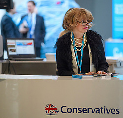 © Licensed to London News Pictures. 03/10/2017. Manchester, UK. A woman flicks through the conference program on day three of the Conservative Party Conference. The four day event is expected to focus heavily on Brexit, with the British prime minister hoping to dampen rumours of a leadership challenge. Photo credit: Ben Cawthra/LNP
