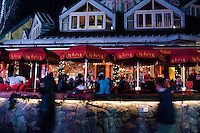 The lights on La Bocca Restaurant glow as visitors stroll by during the 2010 Olympic Winter Games in Whistler, BC Canada.