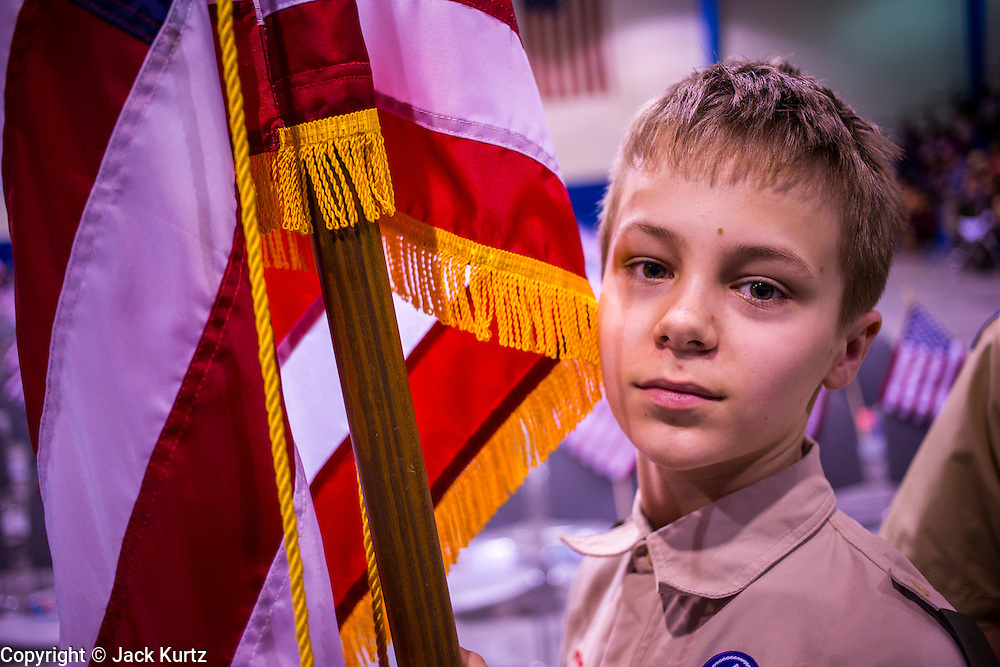 04 JULY 2012 - PHOENIX, AZ:  A member of Boy Scout Troop 244 holds the American flag before posting the colors at a naturalization ceremony in Phoenix Wednesday. About 250 people, from 62 countries, were naturalized as US citizens during the 24th Annual Fiesta of Independence naturization ceremony at South Mountain Community College in Phoenix Wednesday. The ceremony was presided over by the Honorable Roslyn O. Silver, Chief United States District Court Judge. PHOTO BY JACK KURTZ