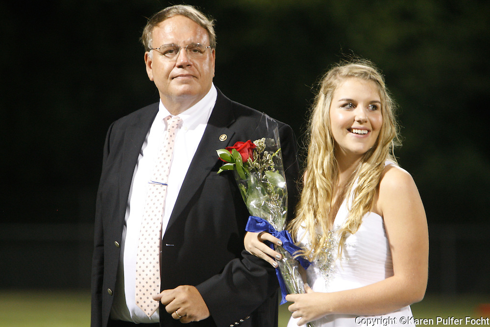 Jessica Focht waits to be introduced on the Homecoming court at her high school in Cordova, Tennessee.