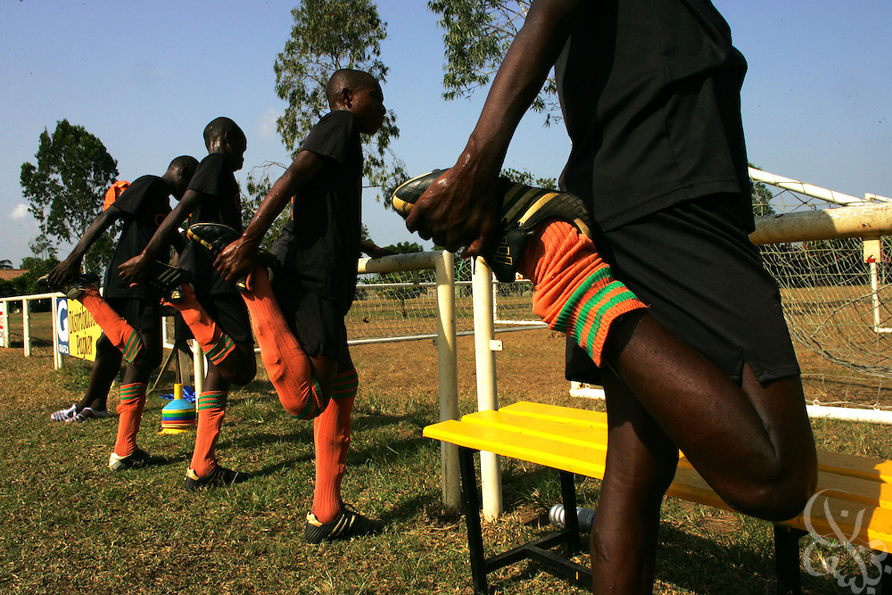 Teenage Ivorian football players stretch out before taking to the pitch for a morning training session at the ASEC football academy February 16, 2006 in Abidjan, Côte d'Ivoire. ASEC academy has an established history of producing top notch footballers who go on to play in the top European football leagues.