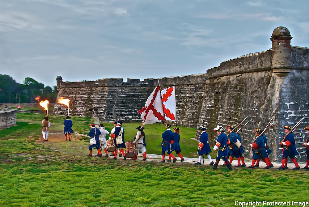 Re-enactors march across the grounds of the Castillo de San Marcos in downtown St. Augustine, Florida