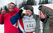 Athetes with intellectual disabilities while medal ceremony after sport competition during VIII Polish Winter Games Special Olympics at Wisla on February 25, 2012...Poland, Wisla, February 25, 2012..Picture also available in RAW (NEF) or TIFF format on special request...For editorial use only. Any commercial or promotional use requires permission...Photo by © Adam Nurkiewicz / Mediasport
