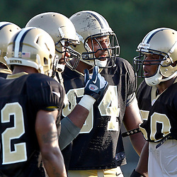 July 29, 2012; Metairie, LA, USA; New Orleans Saints linebacker Curtis Lofton talks to his teammates in the defensive huddle during a training camp practice at the team's practice facility. Mandatory Credit: Derick E. Hingle-US PRESSWIRE