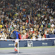 Roger Federer, Switzerland, walks off Louis Armstrong Stadium  after losing in straight sets against Tommy Robredo, Spain, during the Men's Singles competition at the US Open. Flushing. New York, USA. 2nd September 2013. Photo Tim Clayton