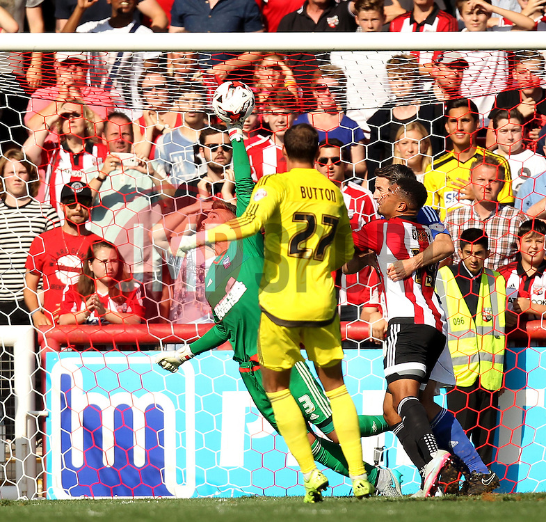 Ipswich Town's Bartosz Bialkowski tries to save the ball in a late goal mouth scramble - Mandatory by-line: Robbie Stephenson/JMP - 07966386802 - 08/08/2015 - SPORT - FOOTBALL - Brentford,England - Griffin Park - Brentford v Ipswich Town - Sky-Bet Championship