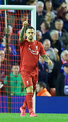 LIVERPOOL, ENGLAND - Wednesday, September 23, 2015: Liverpool's Danny Ings celebrates scoring the fifth penalty of the shoot-out against Carlisle United to put his side 3-2 up during the Football League Cup 3rd Round match at Anfield. (Pic by David Rawcliffe/Propaganda)