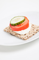 Crispbread with tomato and cucumber slice and cheese