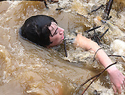 """But Rugemer is soon held by the current  and is snagged on a pile of flotsam under a bridge at the village of Patapsco.  The flash flood from Hurricane Irene  proves too much for the teen and he yells to his friends, """"I can't breathe."""""""