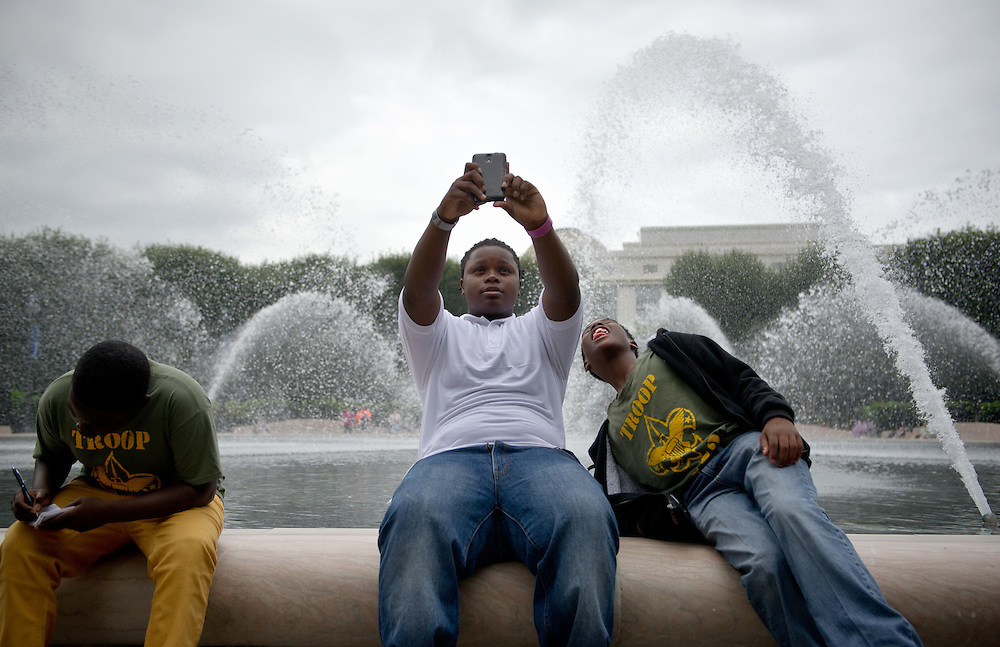 "Matthew Henderson (center) takes a selfie as Lenzel Robinson leans in to ""photo bomb"" him as Boy Scout Troop 772 rests at the fountain in the National Gallery of Art Sculpture Garden on their final day in Washington, D.C. on July 24, 2014. (XAVIER MASCAREÑAS/TREASURE COAST NEWSPAPERS)"