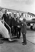 13/06/1963<br /> 06/13/1963<br /> 13 June 1963<br /> Departure of delegates to Furniture Congress in Zurich from Dublin Airport. Mr. Cahir O'Doherty, (right) Lep Transport, bids farewell to a group of executives in the furniture trade. (included are Mr. Sean Walsh, General Manager, Atlas Furnishing Co. Ltd.; Mr. H. Feldman, Burke and Locke, Navan and Mr. Michael Roche, secretary of the Furniture Association, Leader of the group.