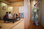 Fukuyu,geisha and Fukukimi,'maiko' (geisha apprentice) workimg in Miyaki tea house (o-chaia).Geisha's distric of Miyagawacho.Kyoto. Kansai, Japan.
