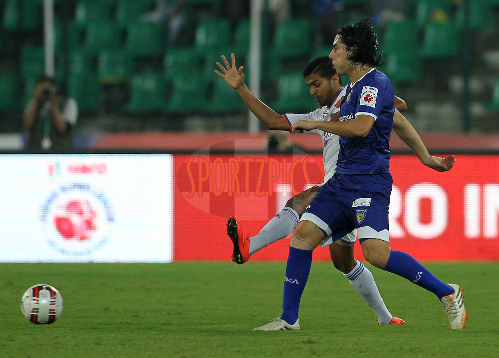 Jairo Andres Suarez Carvajal of Chennaiyin FC and Mandar Rao Dessai of FC Goa in action during match 50 of the Hero Indian Super League between Chennaiyin FC and FC Goa held at the Jawaharlal Nehru Stadium, Chennai, India on the 5th December 2014.<br /> <br /> Photo by:  Vipin Pawar/ ISL/ SPORTZPICS