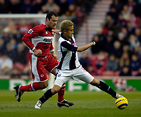 Photo: Jed Wee.<br /> Middlesbrough v West Bromwich Albion. The Barclays Premiership. 27/11/2005.<br /> <br /> West Brom's Junichi Inamoto (R) controls the ball as Middlesbrough's Mark Viduka looks on.