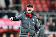 Liverpool manager Jurgen Klopp pointing during the warm up ahead of the Premier League match between Bournemouth and Liverpool at the Vitality Stadium, Bournemouth, England on 7 December 2019.