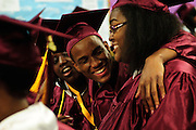 Christ the King Jesuit College Preparatory School senior Michael Washington, 19, celebrates with fellow graduates before the school's First Commencement Exercises on Saturday, June 9th 2012.  The institution is a beacon of hope amid one of the city's most impoverished neighborhoods, bucking low graduation rate trends with a 100% graduation and college acceptance rate. Brian J. Morowczynski/ViaPhotos.