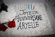 Birthday cake with red and white  roses and candles.