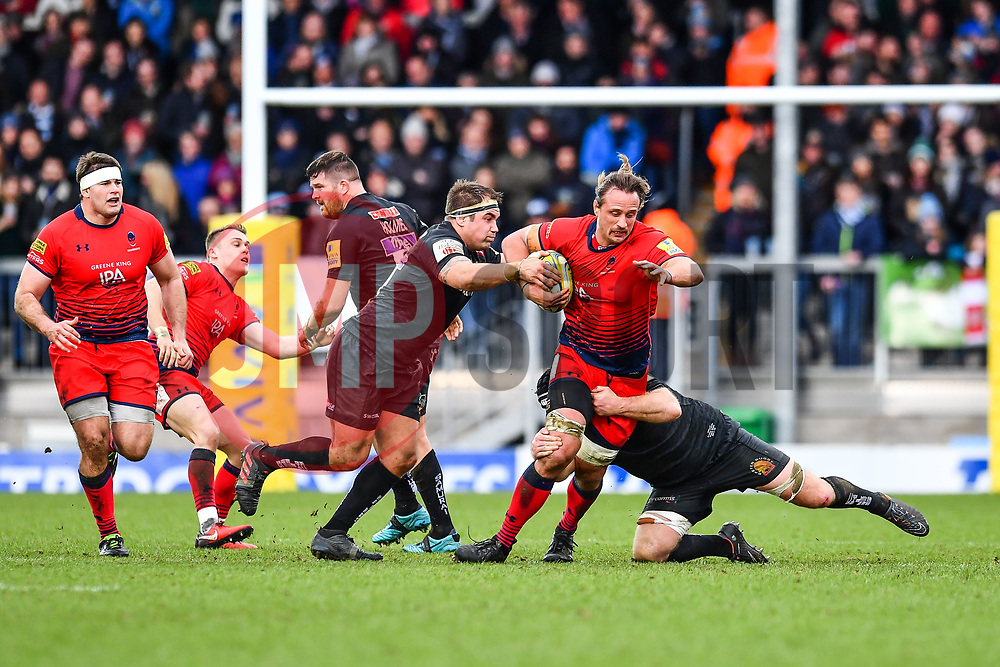 Anton Bresler of Worcester Warriors is tackled by Thomas Waldrom of Exeter Chiefs - Mandatory by-line: Craig Thomas/JMP - 10/02/2018 - RUGBY - Sandy Park Stadium - Exeter, England - Exeter Chiefs v Worcester Warriors - Aviva Premiership