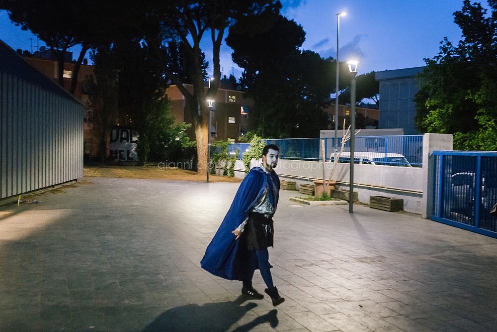ROME, ITALY - 27 JUNE 2017: Opera singer Maharram Huseynov (in the role of Don Giovanni) is seen here shortly before the premiere of the &quot;Don Giovanni OperaCamion&quot;, an open-air opera performed on a truck, at the Aldo Fabrizi library (used as a changing room) in San Basilio, a suburb in Rome, Italy, on June 27th 2017.<br /> <br /> Director Fabio Cherstich&rsquo;s idae of an &ldquo;opera truck&rdquo; was conceived as a way of bringing the musical theatre to a new, mixed, non elitist public, and have it perceived as a moment of cultural sharing, intelligent entertainment and no longer as an inaccessible and costly event. The truck becomes a stage that goes from square to square with its orchestra and its company of singers in Rome. <br /> <br /> &ldquo;Don Giovanni Opera Camion&rdquo;, after &ldquo;Don Giovanni&rdquo; by Wolfgang Amadeus Mozart is a new production by the Teatro dell&rsquo;Opera di Roma, conceived and directed by Fabio Cherstich. Set, videos and costumes by Gianluigi Toccafondo. The Youth Orchestra of the Teatro dell&rsquo;Opera di Roma is conducted by Carlo Donadio.
