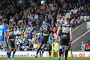 Jamie Allen wins a header during the EFL Sky Bet League 1 match between Rochdale and Bury at Spotland, Rochdale, England on 26 August 2017. Photo by Daniel Youngs.