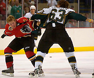 9/29/05  Omaha, NE Omaha Knight's Ryan Cuthbert squares off with the Stars' BJ Crombeen at the Omaha Civic Auditorium Thursday night,.(photo by Chris Machian/Prarie Pixel Group)