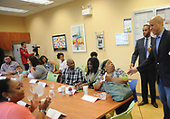 On right, US Senator Cory Booker (D-NJ) is greeted by Angela Long (seed, 2nd from right) before he spoke at South Jersey Family Medical Center Saturday, July 29, 2017 in Burlington, New Jersey. (Photo by William Thomas Cain)