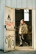 Raver smiling through doorway at NYE party, France December 2011