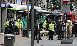 © Licence to London News Pictures. 07/07/2016. A person being treated at the scene by emergency services, where a bus crashed in to a branch of Halifax bank in the centre of Darlington, County Durham. There are reports of serious injury and two people trapped under the vehicle.  Photo Credit: Stuart Boulton/LNP