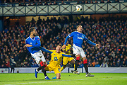 Mateus Uribe (#16) of FC Porto goes down in the penalty box, between Connor Goldson (#6) of Rangers FC and James Tavernier (#2) of Rangers FC during the Group G Europa League match between Rangers FC and FC Porto at Ibrox Stadium, Glasgow, Scotland on 7 November 2019.