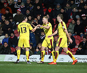 Burnley midfielder Scott Arfield celebrates scoring with Burnley midfielder Joey Barton and Burnley striker Sam Vokes during the Sky Bet Championship match between Brentford and Burnley at Griffin Park, London, England on 15 January 2016. Photo by Matthew Redman.
