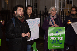 London, UK. 6 December, 2019. Victor Salinas (l), an expert on geography, the environment and decentralisation in rural Chile, addresses activists from groups including the Campaign Against Climate Change, the Chilean Assembly in London, Medact, Biofuelwatch and UK Student Climate Network holding a vigil outside the Chilean embassy in solidarity with the people of Chile following the transfer of UN climate negotiations from Santiago to Madrid with the consequent effect of marginalising the voices of activists and communities from the Global South.