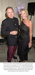 SIR ANTHONY & LADY BAMFORD at a fashion show and dinner in London on 16th April 2002.OZA 261