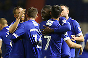 Freddie Ladapo of Oldham Athletic is congratulated by Ryan Flynn of Oldham Athletic and other team mates after scoring the first goal of the game to make the score 1-0 during the EFL Sky Bet League 1 match between Oldham Athletic and Scunthorpe United at Boundary Park, Oldham, England on 18 October 2016. Photo by Simon Brady.